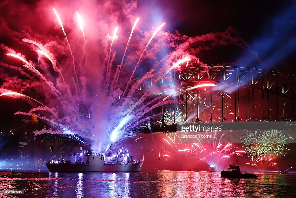 Fireworks explode as the Royal Australian Navy warship HMAS Sydney sits underneath the Sydney Harbour Bridge during the 2013 International Fleet Review on October 5, 2013 in Sydney, Australia. Over 50 ships participate in the International Fleet Review at Sydney Harbour to commemorate the 100 year anniversary of the Royal Australian Navy's fleet arriving into Sydney. Prince Harry is an official guest of the Australian Government and will take part in the fleet review during his two-day visit to Australia.