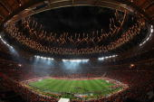 Fireworks explode as the Spain team celebrate victory with the World Cup trophy following the 2010 FIFA World Cup South Africa Final match between...