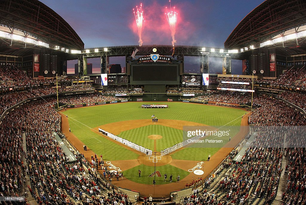 Fireworks explode as the St. Louis Cardinals and the Arizona Diamondbacks stand attended for the National Anthem before the MLB Opening Day game at Chase Field on April 1, 2013 in Phoenix, Arizona.