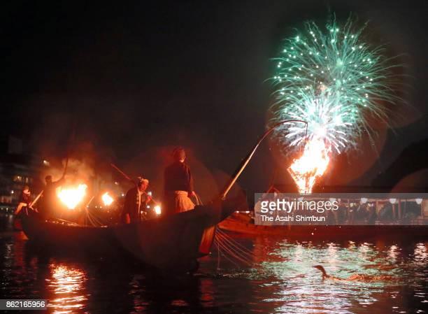 Fireworks explode as the 'Ukai' cormorant fishing season concludes at Nagaragawa River on October 15 2017 in Gifu Japan