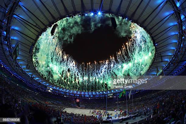 Fireworks explode at the 'Heroes of the Games' segment during the Closing Ceremony on Day 16 of the Rio 2016 Olympic Games at Maracana Stadium on...