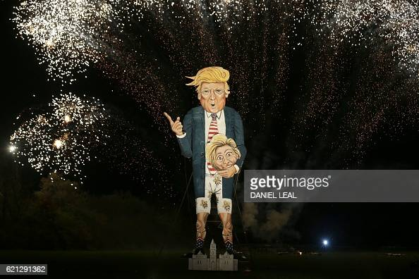 Fireworks explode behind an effigy of US presidential candidate Donald Trump before it is burned as the 'Celebrity Guy' at the Edenbridge Bonfire...