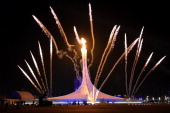 Fireworks explode behind the Olympic flame cauldron during the Opening Ceremony of the Sochi Winter Olympics on February 7 2014 in Sochi AFP PHOTO /...