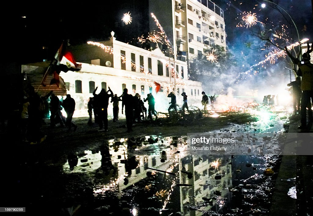 CONTENT] Fireworks explode during intense clashes between riot police and protesters near Tahrir square. The clashes broke out shortly after the Port Said stadium tragedy which left over 70 football fan dead in one of the biggest disasters of football in Egypt's history.