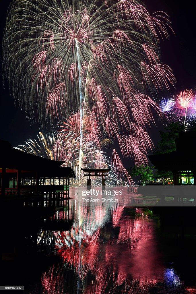 Fireworks explode during the Miyajima Fireworks Festival at Itsukushima Shrine on August 11, 2012 in Hatsukaichi, Hiroshima, Japan.