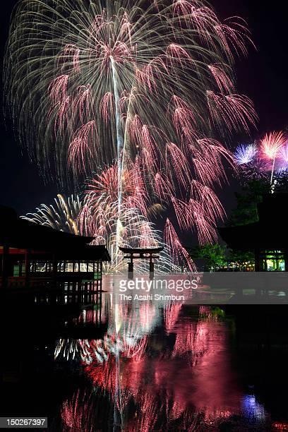 Fireworks explode during the Miyajima Fireworks Festival at Itsukushima Shrine on August 11 2012 in Hatsukaichi Hiroshima Japan