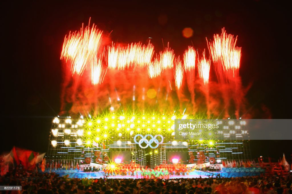 Fireworks explode during the opening launch ceremony held at the Qingdao Olympic Sailing Center during day 1 of the Beijing 2008 Olympic Games on...