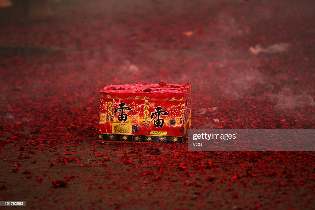 Fireworks explode for good fortune on a road on February 16, 2013 in Xuchang, Henan Province of China. Local businesses in China rushed to set off fireworks ahead of the first business day after the New Year, as people believe it brings a propitious omen for the business during the year.