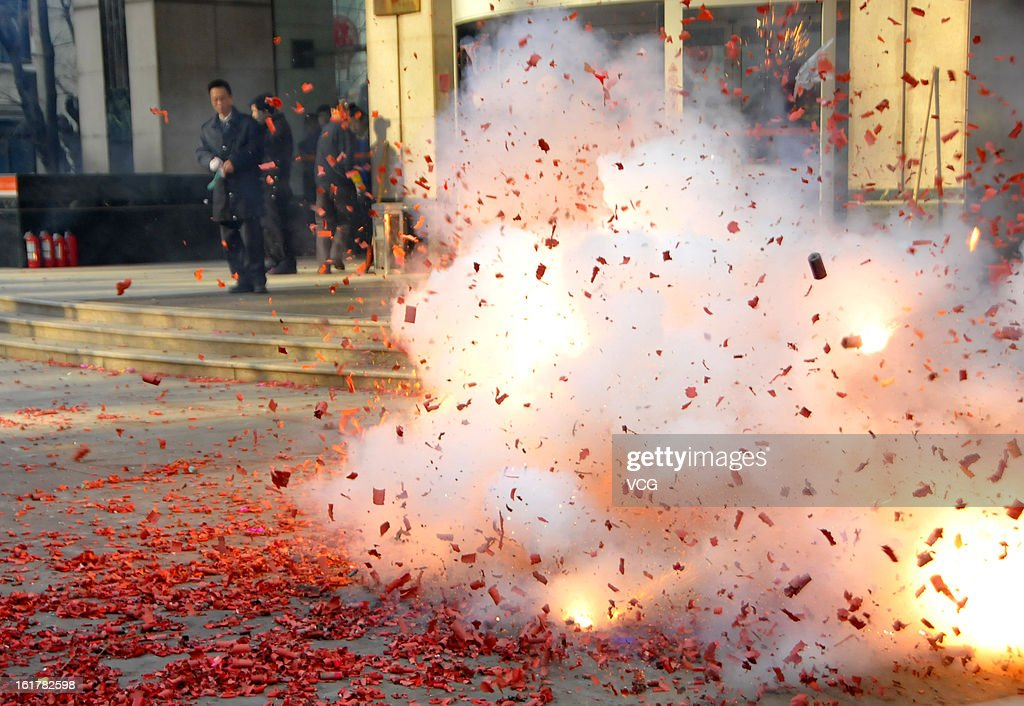 Fireworks explode for good fortune on February 16, 2013 in Dalian, Liaoning Province of China. Local businesses in China rushed to set off fireworks ahead of the first business day after the New Year, as people believe it brings a propitious omen for the business during the year.