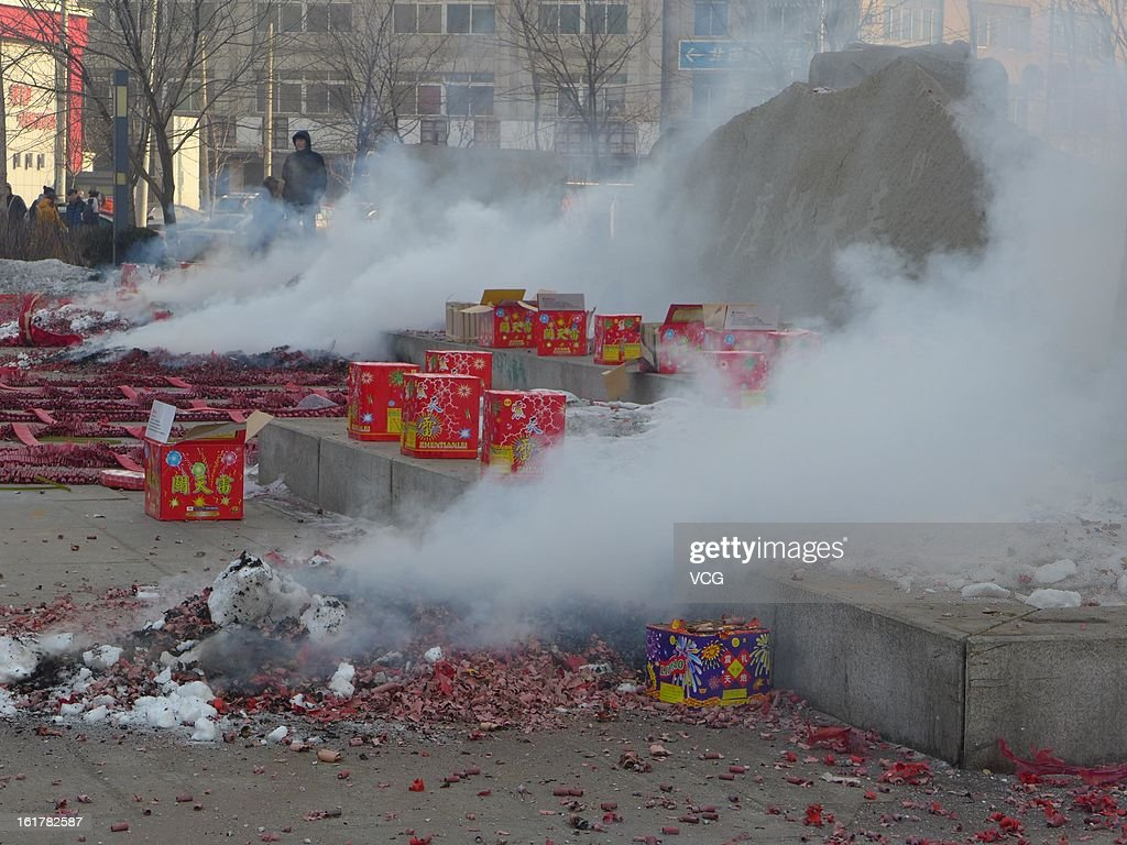 Fireworks explode for good fortune on February 16, 2013 in Shenyang, Liaoning Province of China. Local businesses in China rushed to set off fireworks ahead of the first business day after the New Year, as people believe it brings a propitious omen for the business during the year.
