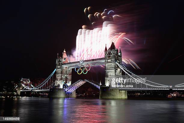 Fireworks explode from Tower Bridge during the opening ceremony of the London 2012 Olympic Games on July 27 2012 in London England