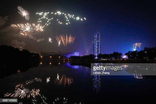 Fireworks explode in the air during the AsiaPacific Economic Cooperation Summit welcome Banquet at the National Stadium on November 10 2014 in...