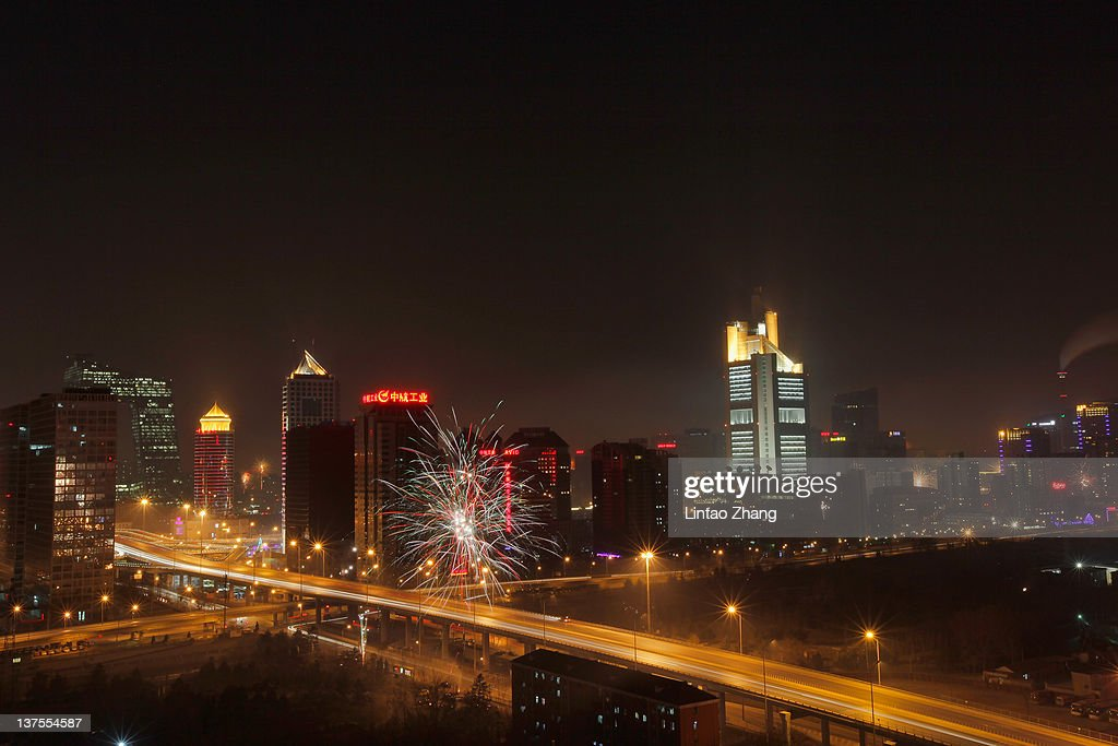 Fireworks explode in the air to celebrate Chinesee New Year on January 22, 2012 in Beijing, China. The Chinese Lunar New Year, known as the Spring Festival, is based on the Lunisolar Chinese calendar. It is celebrated from the first day of the first month of the lunar year and ends with the Lantern Festival on the fifteenth day.