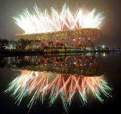 Fireworks explode next to the National Stadium also known as the 'Bird's Nest' during the opening ceremony of the 2008 Beijing Olympic Games on...