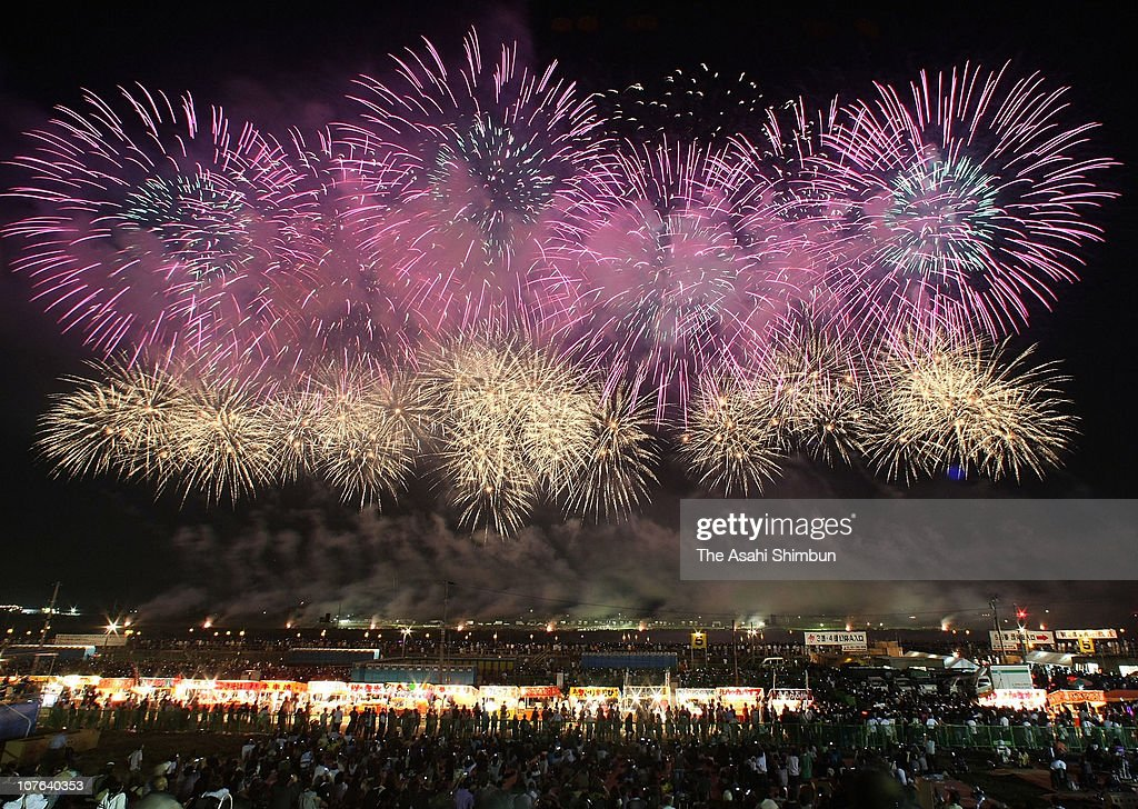 Fireworks explode on the Omono River on August 28, 2010 in Daisen, Akita, Japan. The festival marks 100th anniversary, 800,000 people enjoy 18,000 fireworks.