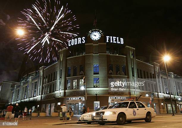 Fireworks explode over Coors Field after the interleague game between the Detroit Tigers and the Colorado Rockies on July 3 2004 in Denver Colorado...
