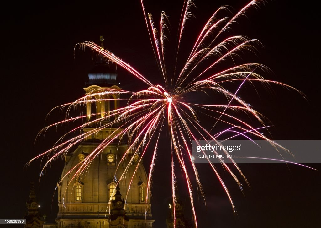 Fireworks explode over Dresden's Church of Our Lady (Frauenkirche) on New Year's Eve on December 31, 2012 in Dresden, eastern Germany. MICHAEL