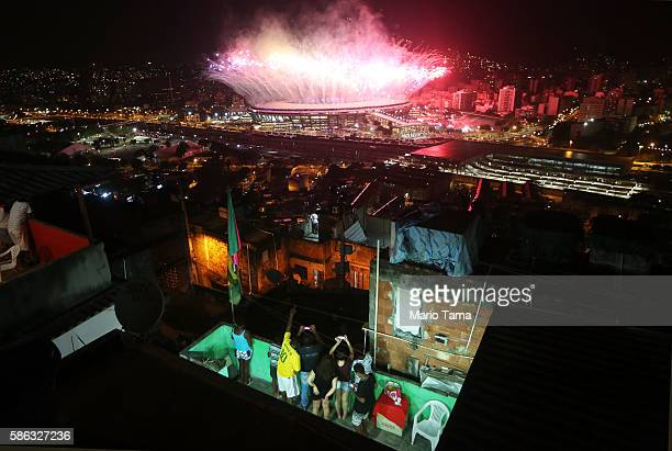 Fireworks explode over Maracana stadium with the Mangueira 'favela' community in the foreground during opening ceremonies for the Rio 2016 Olympic...