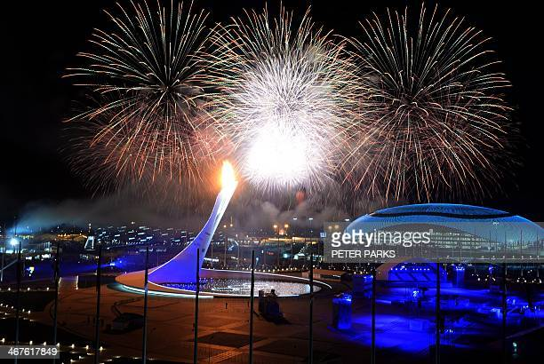 Fireworks explode over Olympic flame cauldron at the end of the Opening Ceremony of the Sochi Winter Olympics on February 7 2014 in Sochi AFP PHOTO /...