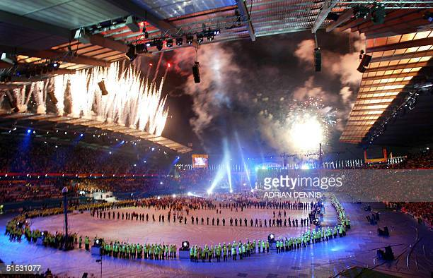 Fireworks explode over the city of Manchester stadium during the closing ceremony of The XVII Commonwealth Games in Manchester 04 August 2002 AFP...