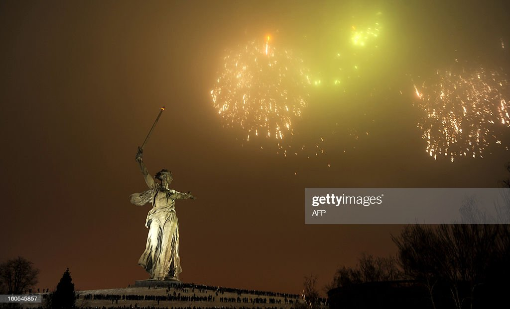Fireworks explode over the giant Mother Motherland statue, at the Stalingrad Battle memorial, in the Russian city of Volgograd, late on February 2, 2013. Russia marked today the 70th anniversary of a brutal battle in which the Red Army defeated Nazi forces and changed the course of World War II. AFP PHOTO / MIKHAIL MORDASOV