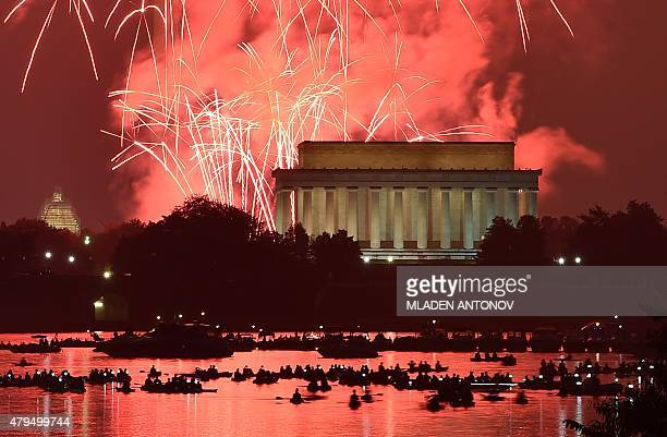 Fireworks explode over the Lincoln Memorial the Washington Monument and the US Capitol in celebration of Independence Day in Washington DC on July 4...