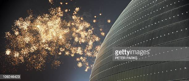 Fireworks explode over the National Theatre in Beijing for the annual Lantern Festival on February 17 2011 The Lantern Festival marks the end of...