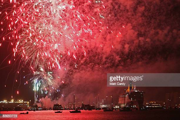 Fireworks explode over the Queen Elizabeth 2 luxury liner to mark her final departure from her home port on 11 November 2008 in Southampton England...