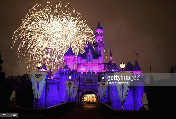 Fireworks explode over The Sleeping Beauty Castle as part of the Disney Premiere of 'RememberDreams Come True' the biggest firework display in...