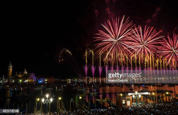 Fireworks explode over the St Mark's Basin and S George Island for the Redentore Celebrations on July 19 2014 in Venice Italy Redentore which is in...