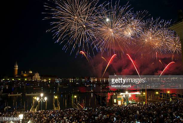 Fireworks explode over the St Mark's Basin for the Redentore Celebrations on July 20 2013 in Venice Italy Redentore which is in remembrance of the...