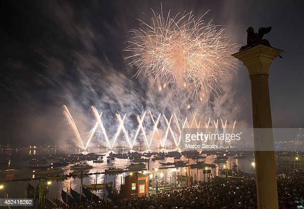 Fireworks explode over the St Mark's Basin for the Redentore Celebrations on July 19 2014 in Venice Italy Redentore which is in remembrance of the...