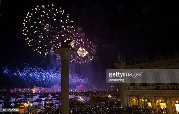 Fireworks explode over the St Mark's Basin for the Redentore Celebrations on July 18 2015 in Venice Italy Redentore which is in remembrance of the...