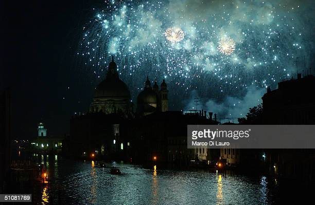 Fireworks explode over the the Church of the Salute during the Festa del Redentore in Venice July 17 2004 This festival is second only to the...