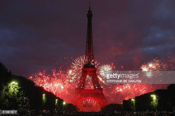 Fireworks explode over Trocadero behind the Eiffel Tower during the traditional celebration of Bastille Day 14 July 2004 in Paris