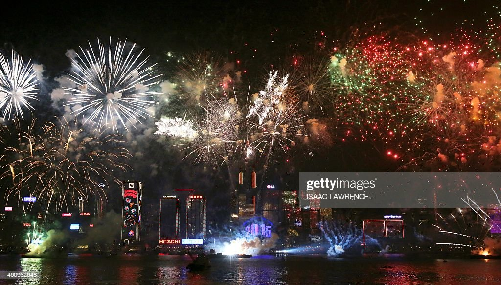 Fireworks explode over Victoria Harbour in Hong Kong on January 1 2015 Just like previous years the city's iconic skyline along Victoria Harbour will...