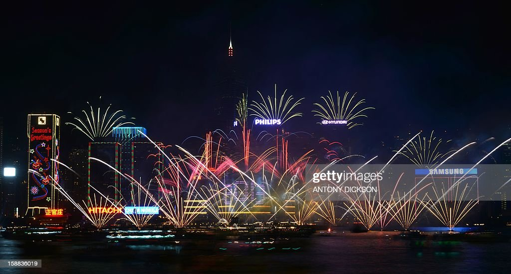 Fireworks explode over Victoria harbour to celebrate the new year, in Hong Kong on January 1, 2013. AFP PHOTO / Antony DICKSON