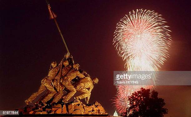 Fireworks explode over Washington DC behind the Iwo Jima Marine Memorial in Arlington VA 04 July Thousands came out to watch the annual fireworks...