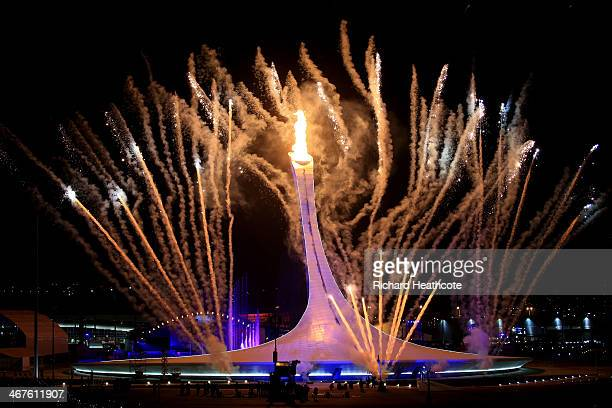 Fireworks explode while the Olympic flame is lit during the Opening Ceremony of the Sochi 2014 Winter Olympics at Fisht Olympic Stadium on February 7...