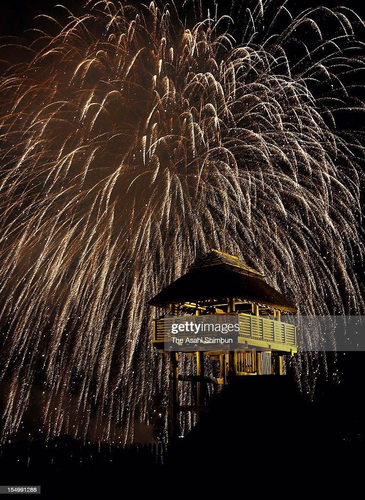 Fireworks exploded over the Yoshinogari Historial Park during the Yoshinogari Furusato Fire Festival on October 27, 2012 in Kanzaki, Saga, Japan.