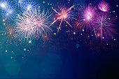 Abstract fireworks celebration on festive bokeh light background. Fireworks for copyspace and background