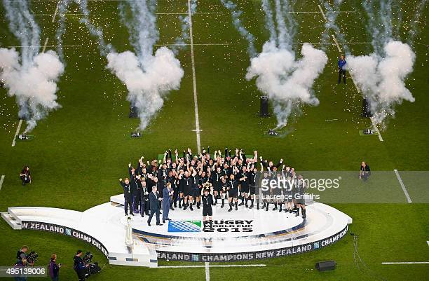 Fireworks go off as Richie McCaw of the New Zealand All Blacks lifts the Webb Ellis Cup following the victory against Australia in the 2015 Rugby...