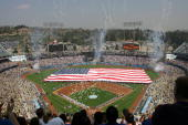 Fireworks go off during the national anthem before the game between the Los Angeles Dodgers and the Colorado Rockies on opening day at Dodger Stadium...