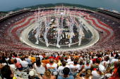 Fireworks go off during the National Anthem prior to the start of the NASCAR Nextel Cup Series Sharpie 500 at Bristol Motor Speedway on August 25...