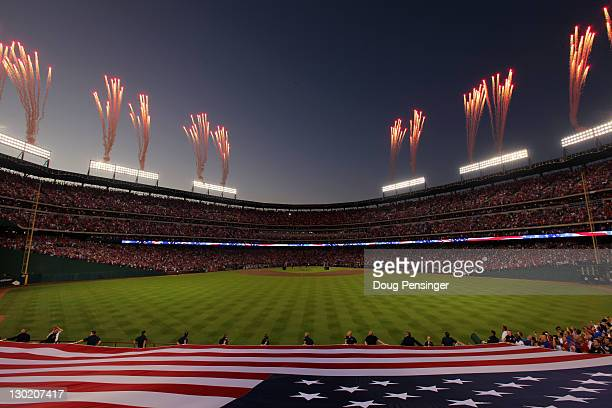 Fireworks go off during the singing of the national anthem prior to Game Five of the MLB World Series between the St Louis Cardinals and the Texas...
