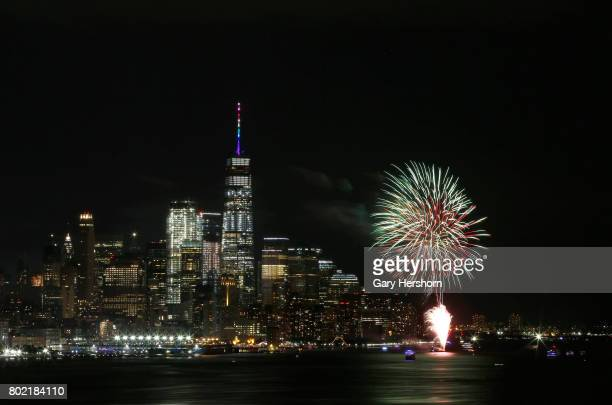 Fireworks go off in front of lower Manhattan and One World Trade Center in New York City celebrating NYC Pride Day on June 25 as seen from Weehawken...