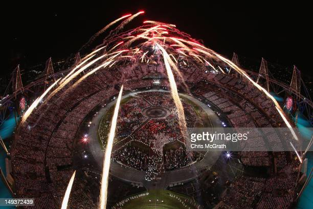 Fireworks go off over the Olympic Stadium during the Opening Ceremony of the London 2012 Olympic Games at the Olympic Stadium on July 27 2012 in...