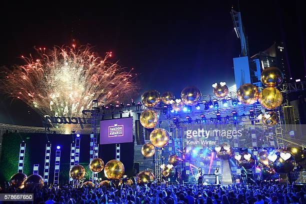 Fireworks go off while recording artists Jahan Yousaf and Yasmine Yousaf of musical group Krewella perform onstage at the MTV Fandom Awards San Diego...