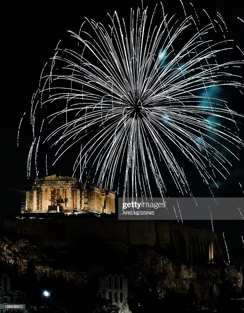 Fireworks illuminate the ancient temple of Parthenon atop the Acropolis hill during the new year's celebrations in Athens on January 1, 2013.