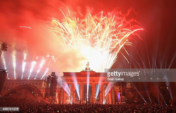 Fireworks illuminate the Brandenburg Gate during celebrations on the 25th anniversary of the fall of the Berlin Wall on November 9 2014 in Berlin...